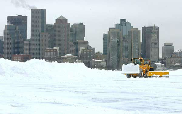 """<div class=""""meta image-caption""""><div class=""""origin-logo origin-image none""""><span>none</span></div><span class=""""caption-text"""">Feb. 2003: Airport runways are cleared in Boston after a blizzard. (Photo/LISA POOLE)</span></div>"""