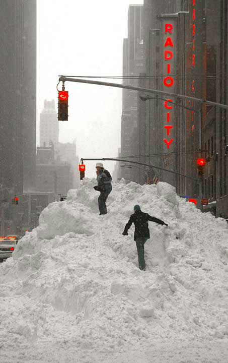 """<div class=""""meta image-caption""""><div class=""""origin-logo origin-image none""""><span>none</span></div><span class=""""caption-text"""">Feb. 2003: People play in the snow in a blizzard that left hundreds of thousands without power. At the time AP called it the worst in seven years. (Photo/ROBERT SPENCER)</span></div>"""