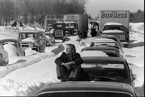 """<div class=""""meta image-caption""""><div class=""""origin-logo origin-image none""""><span>none</span></div><span class=""""caption-text"""">Feb. 1978: A man in Dedham, Mass., waits for snow plows to dig him out. AP reported he had been living at a Red Cross Shelter nearby while he waited. (Photo/Anonymous)</span></div>"""