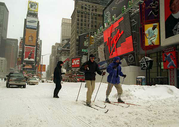 """<div class=""""meta image-caption""""><div class=""""origin-logo origin-image none""""><span>none</span></div><span class=""""caption-text"""">Jan. 1996: People use cross-country skies to traverse Times Square during one of the most powerful blizzard of the 20th century. (Photo/RICHARD DREW)</span></div>"""