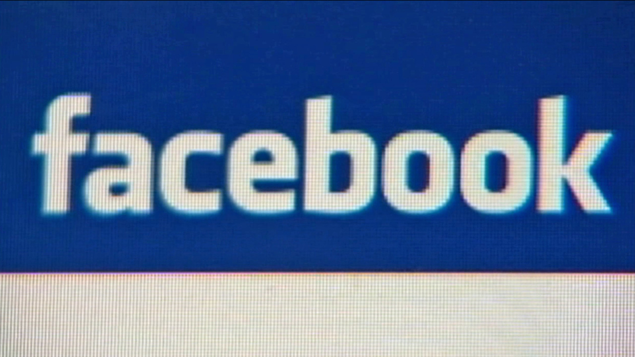 The Facebook logo is seen.