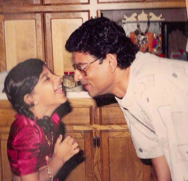 <div class='meta'><div class='origin-logo' data-origin='none'></div><span class='caption-text' data-credit='KTRK Photo'>Pooja Lodhia with her father</span></div>