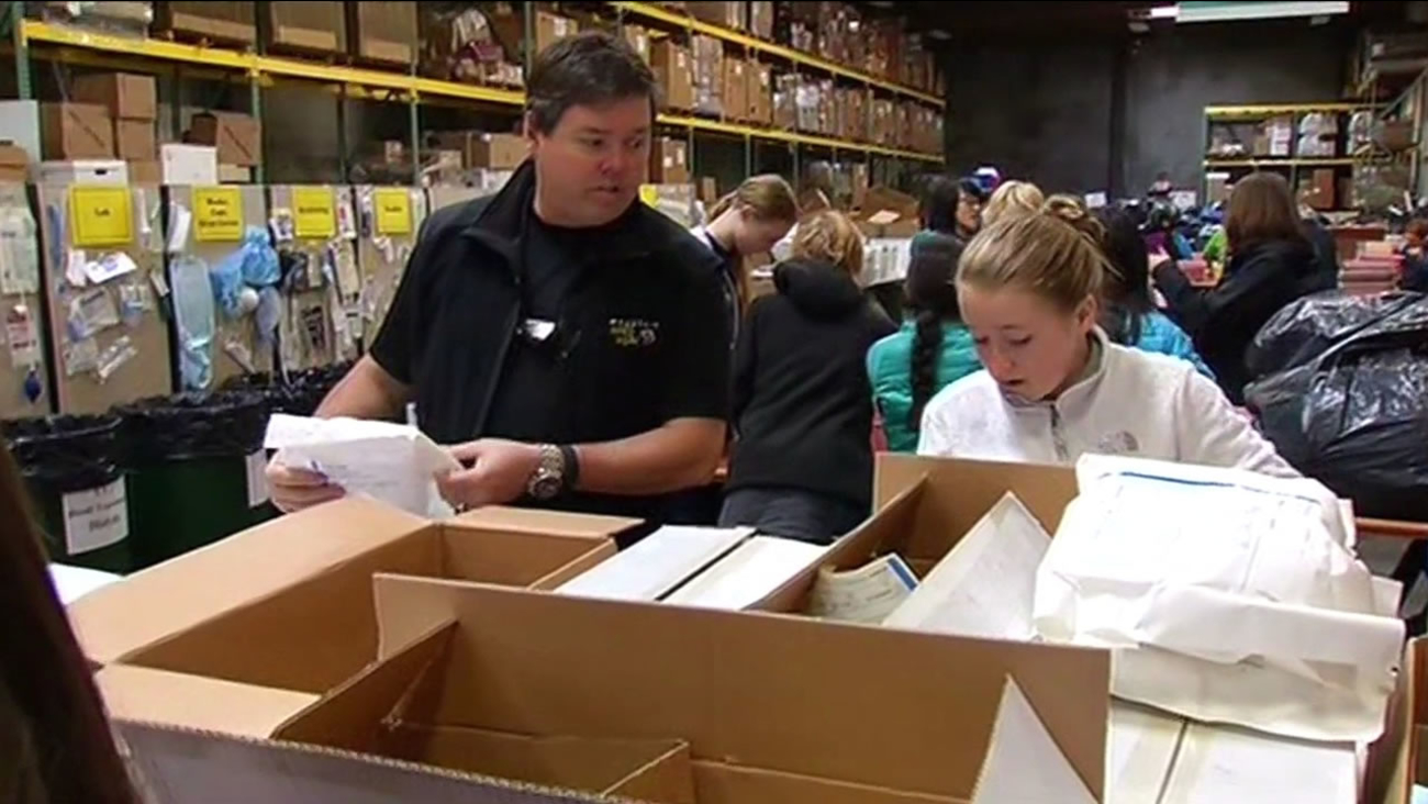 Volunteers at the MedShare Warehouse are packing up supplies that will be shipped to Sierra Leone and Liberia.