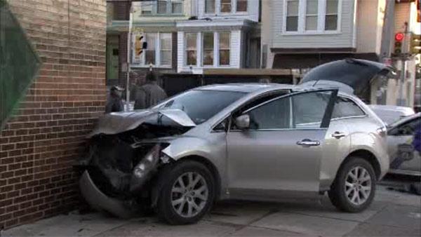Crash sends SUV into side of school in Juniata