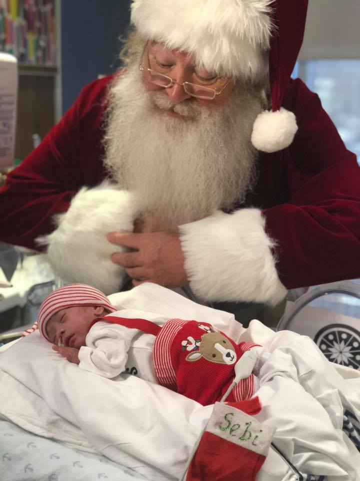 <div class='meta'><div class='origin-logo' data-origin='Creative Content'></div><span class='caption-text' data-credit='Saint Barnabas Medical Center'>Santa Claus visited the babies staying in the level 3 regional neonatal intensive care unit at Saint Barnabas Medical Center in Livingston, New Jersey.</span></div>