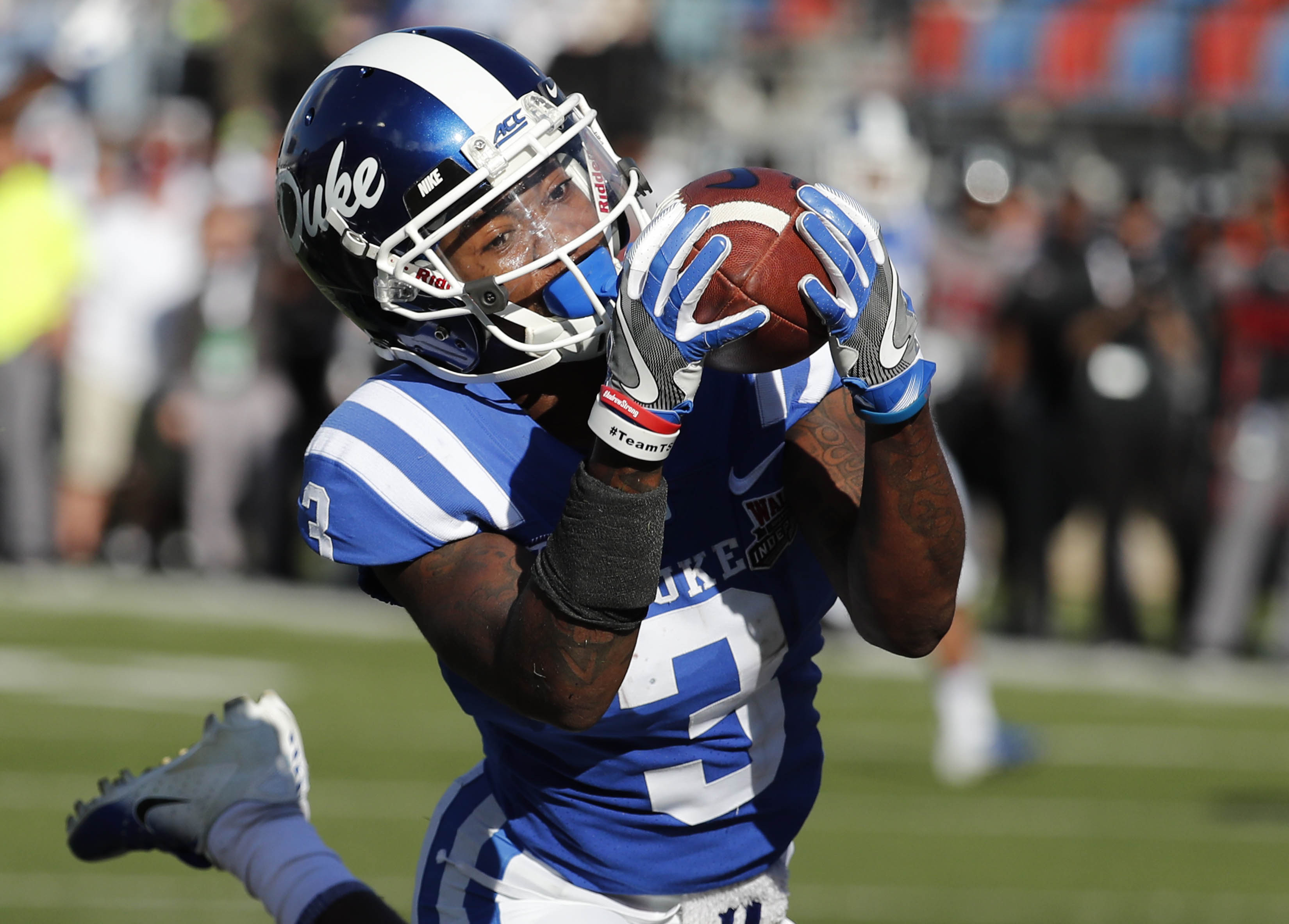 """<div class=""""meta image-caption""""><div class=""""origin-logo origin-image ap""""><span>AP</span></div><span class=""""caption-text"""">Duke wide receiver T.J. Rahming (3) hauls in a touchdown pass reception against Temple during the first half of the Independence Bowl, (Rogelio V. Solis)</span></div>"""