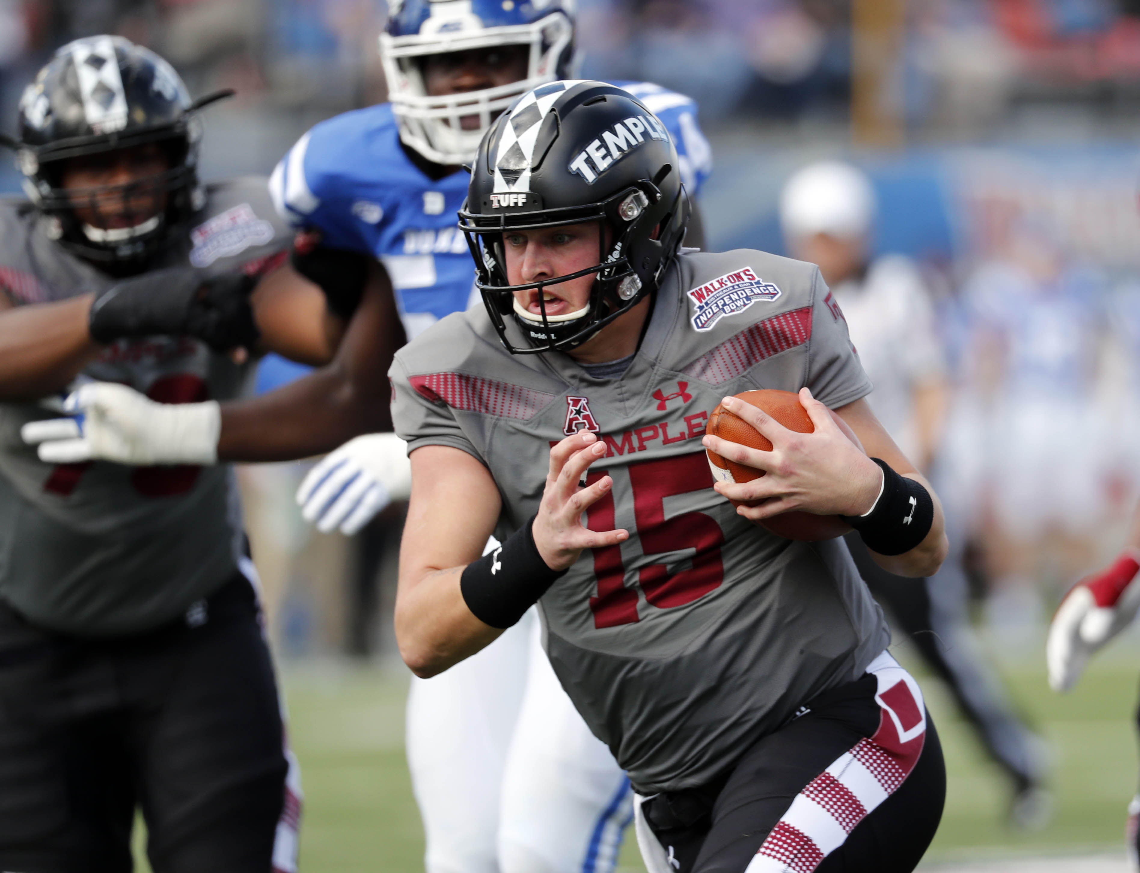 """<div class=""""meta image-caption""""><div class=""""origin-logo origin-image ap""""><span>AP</span></div><span class=""""caption-text"""">Temple quarterback Anthony Russo (15) runs for a short gain against Duke during the first half of the Independence Bowl, (Rogelio V. Solis)</span></div>"""