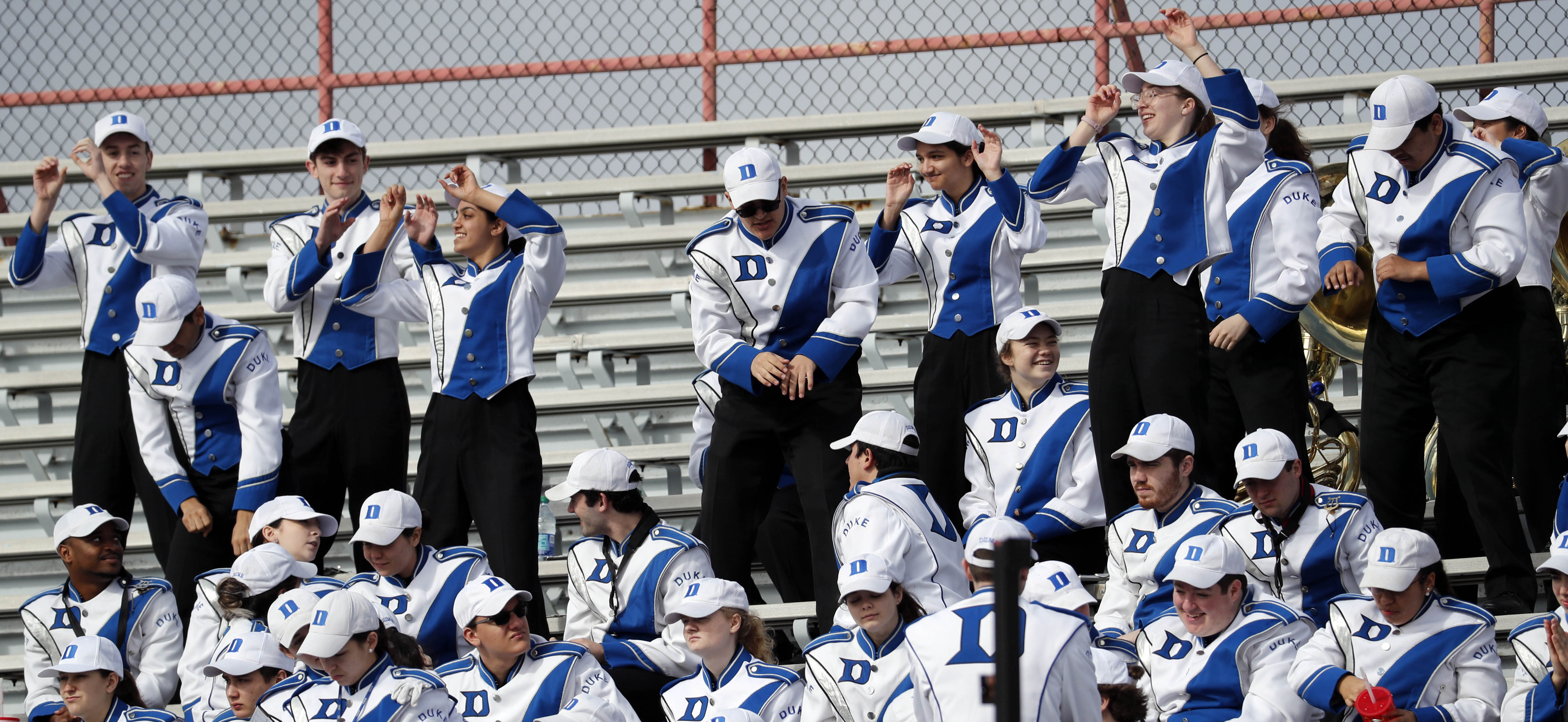 """<div class=""""meta image-caption""""><div class=""""origin-logo origin-image ap""""><span>AP</span></div><span class=""""caption-text"""">Duke band members dance to stadium music prior to the start of the Independence Bowl. (Rogelio V. Solis)</span></div>"""