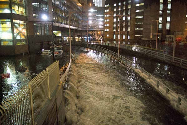 "<div class=""meta image-caption""><div class=""origin-logo origin-image none""><span>none</span></div><span class=""caption-text"">Sea water floods the entrance to the Brooklyn Battery Tunnel, Monday, Oct. 29, 2012, in New York. (AP Photo/ John Minchillo)</span></div>"