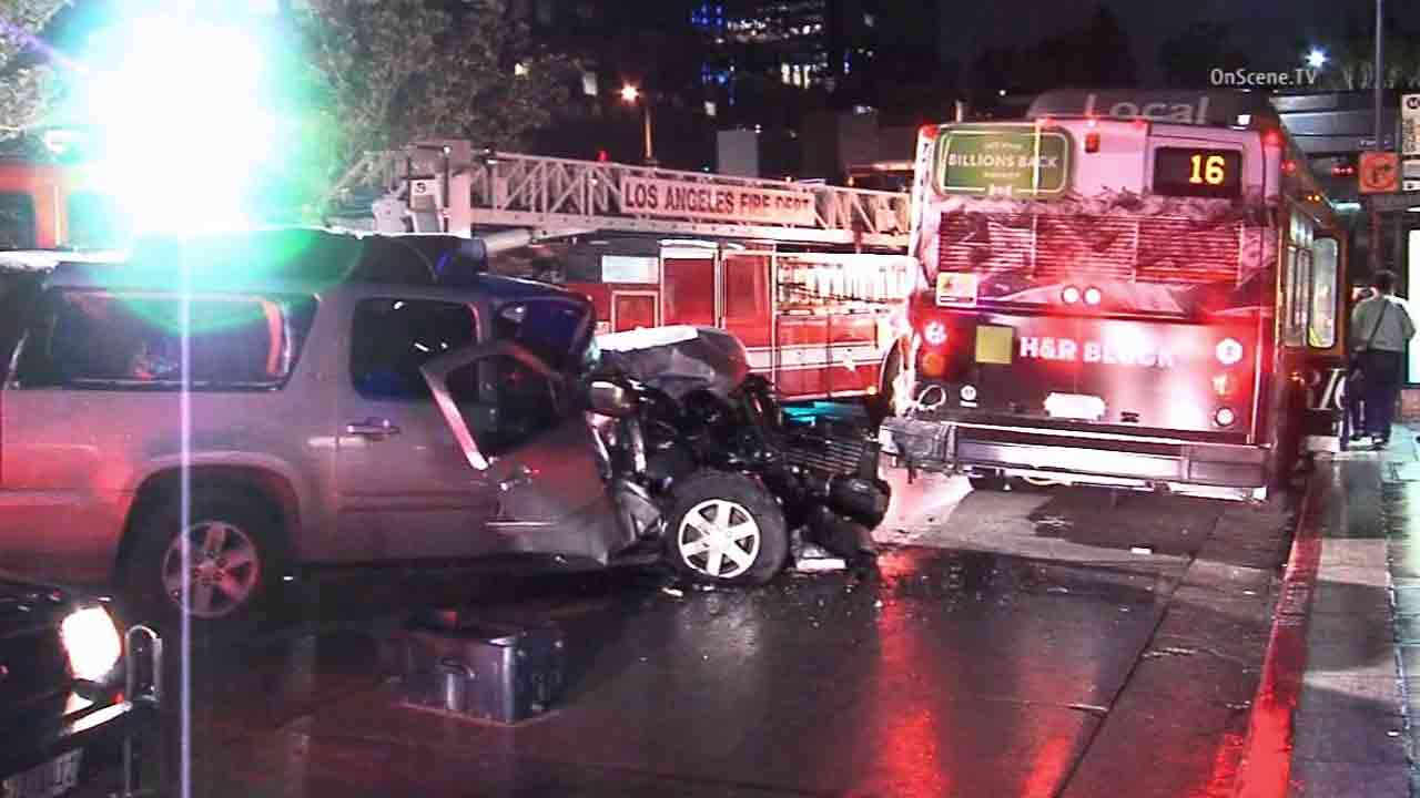 Los Angeles firefighters respond to the scene of a crash involving a Metro bus near 5th and Flower streets in downtown Los Angeles Thursday, Jan. 29, 2015.