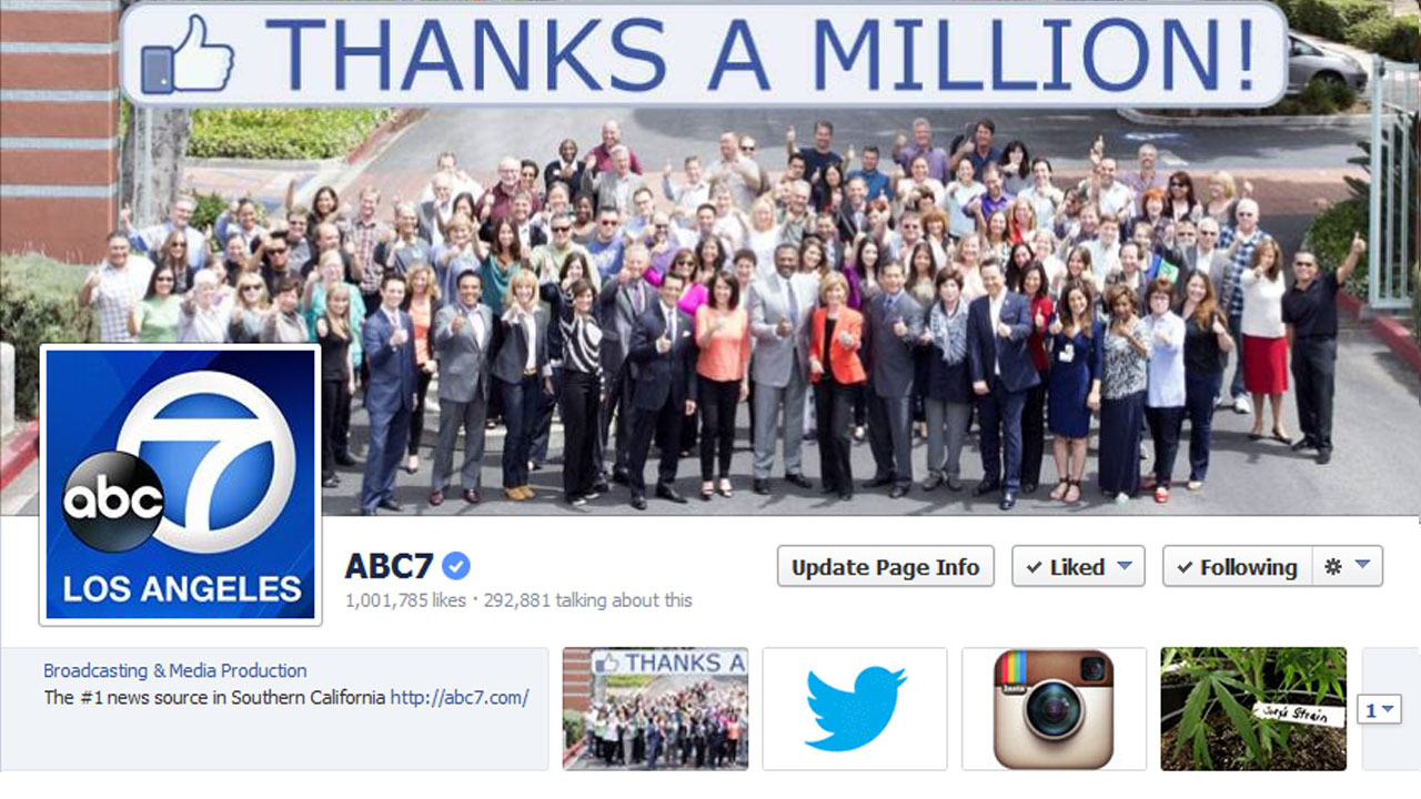 Employees of KABC-TV Los Angeles, ABC7, pose for a photo celebrating the station's Facebook page attracting 1 million fans.