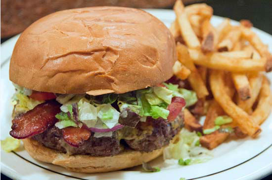 "<div class=""meta image-caption""><div class=""origin-logo origin-image none""><span>none</span></div><span class=""caption-text"">Vic & Anthony's : Their Vic's Burger, usually only available on Fridays, will be available on Super Bowl Sunday. (Landry's, Inc.)</span></div>"