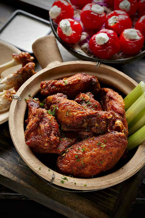 "<div class=""meta image-caption""><div class=""origin-logo origin-image none""><span>none</span></div><span class=""caption-text"">Peli Peli: 12 complementary stuffed peppadews for every 50 wings purchased, 50 wings for $60 or 100 wings for $110. (Peli Peli/Kimberly Park)</span></div>"