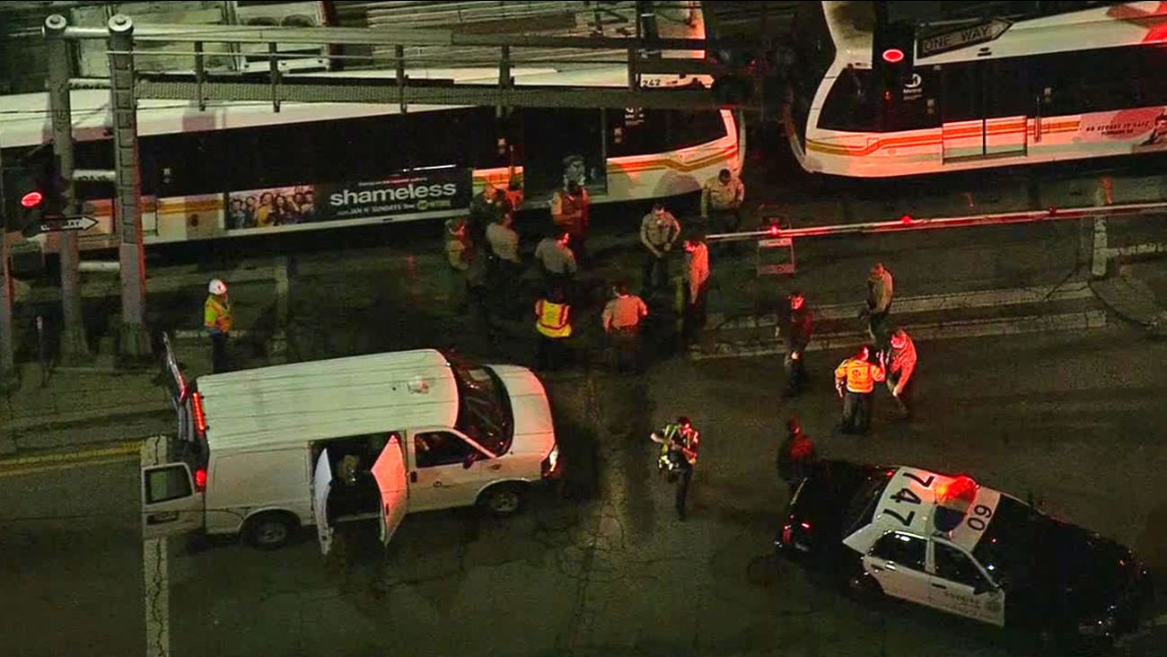 Authorities respond to a fatal collision between a person and a Blue Line train near downtown Los Angeles on Friday, Jan. 30, 2015.