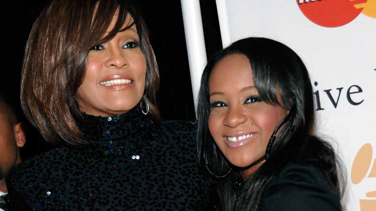 In this Feb. 12, 2011, file photo, singer Whitney Houston, left, and daughter Bobbi Kristina Brown arrive at an event in Beverly Hills, Calif.
