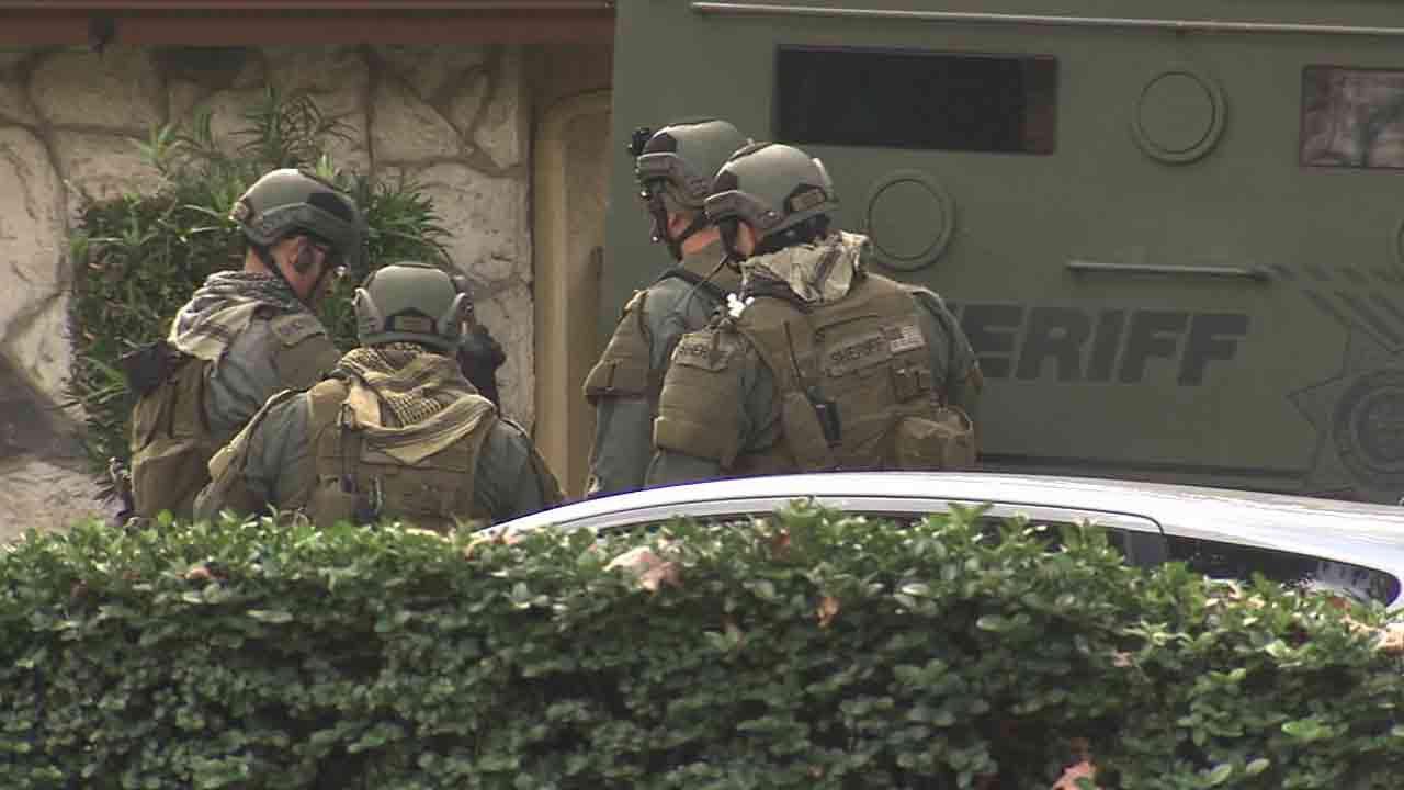 SWAT officers surround an apartment complex in the 1400 block of Randy Street in Upland Saturday, Jan. 31, 2015.