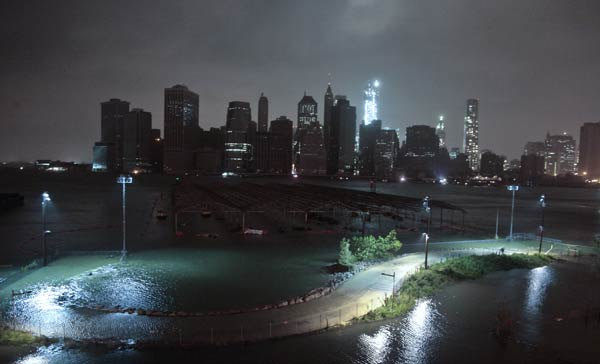 "<div class=""meta image-caption""><div class=""origin-logo origin-image none""><span>none</span></div><span class=""caption-text"">Blacked out lower Manhattan in Sandy's wake. The storm forced the shutdown of mass transit, schools and financial markets, and brought a mix of high winds and soaking rain. (AP Photo/John Minchillo)</span></div>"