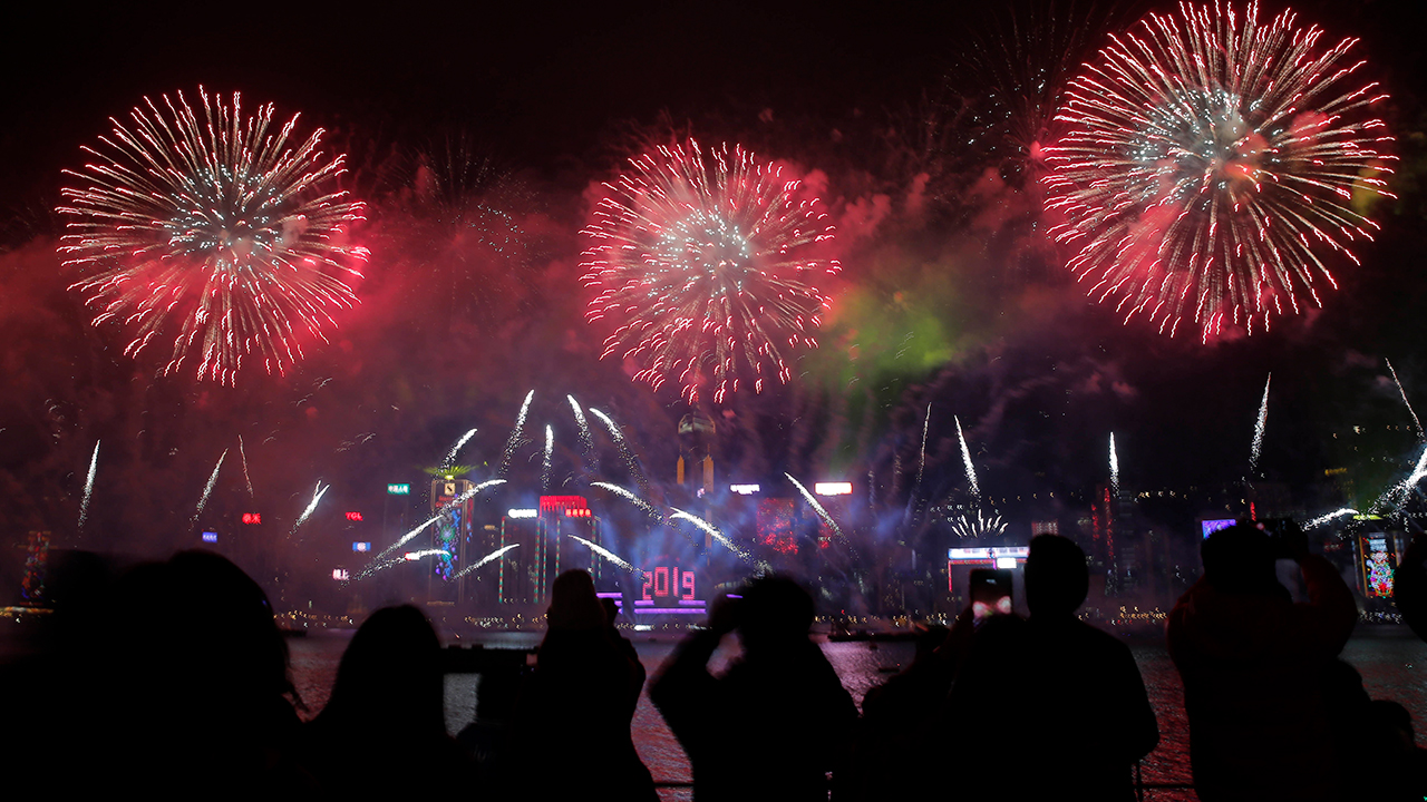 <div class='meta'><div class='origin-logo' data-origin='AP'></div><span class='caption-text' data-credit='AP Photo/Kin Cheung'>Fireworks explode over the Victoria Harbor during New Year's Eve to celebrate the start of year 2019 in Hong Kong, Tuesday, Jan. 1, 2019.</span></div>