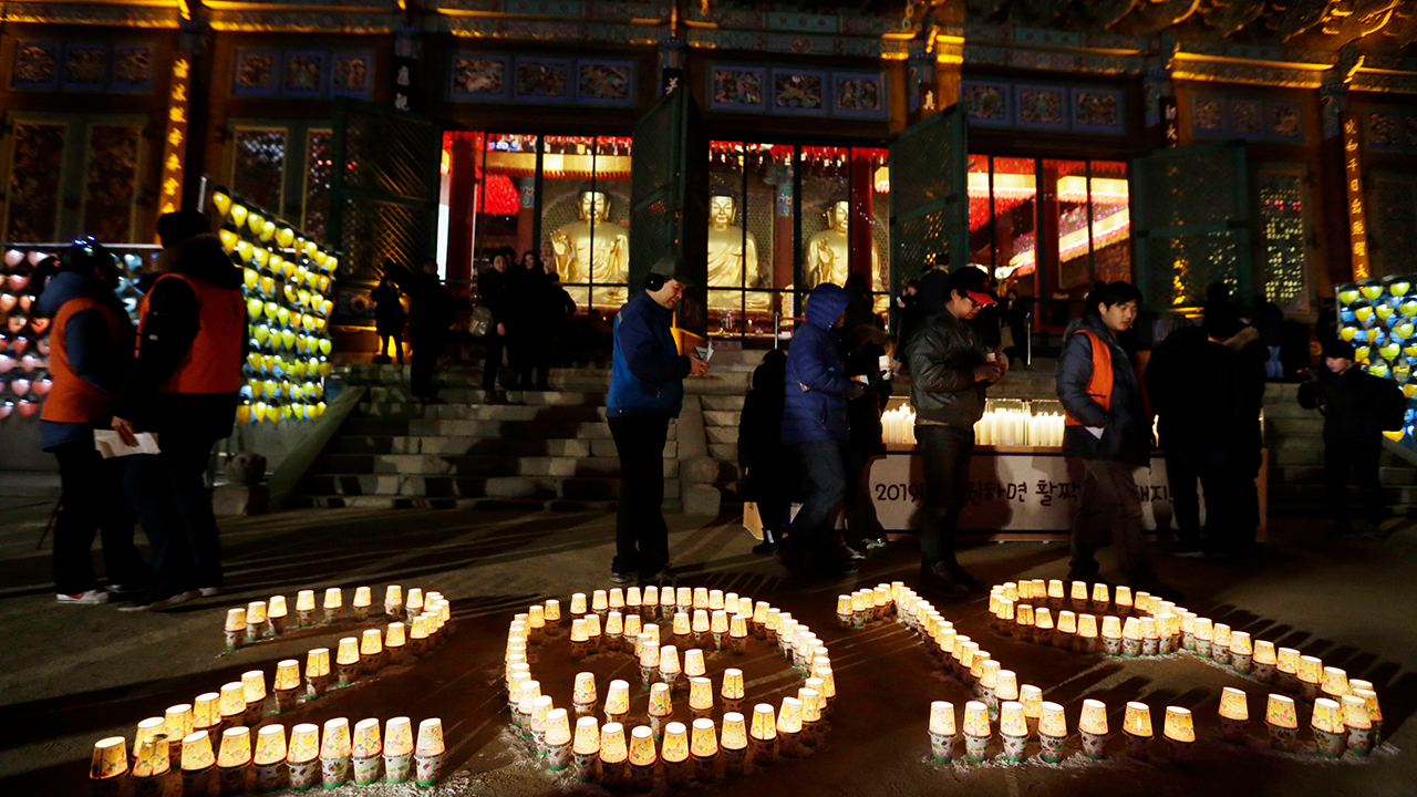 <div class='meta'><div class='origin-logo' data-origin='AP'></div><span class='caption-text' data-credit='AP Photo/Ahn Young-joon'>Buddhists light candles during New Year celebrations at Jogyesa Buddhist temple in Seoul, South Korea, Tuesday, Jan. 1, 2019.</span></div>
