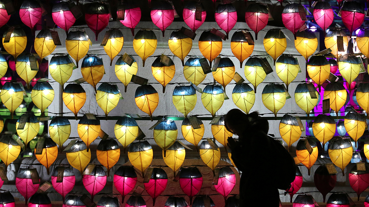 <div class='meta'><div class='origin-logo' data-origin='AP'></div><span class='caption-text' data-credit='AP Photo/Ahn Young-joon'>A woman prays in front of a wall of lanterns to celebrate the New Year at the Jogyesa Buddhist temple in Seoul, South Korea, Monday, Dec. 31, 2018.</span></div>