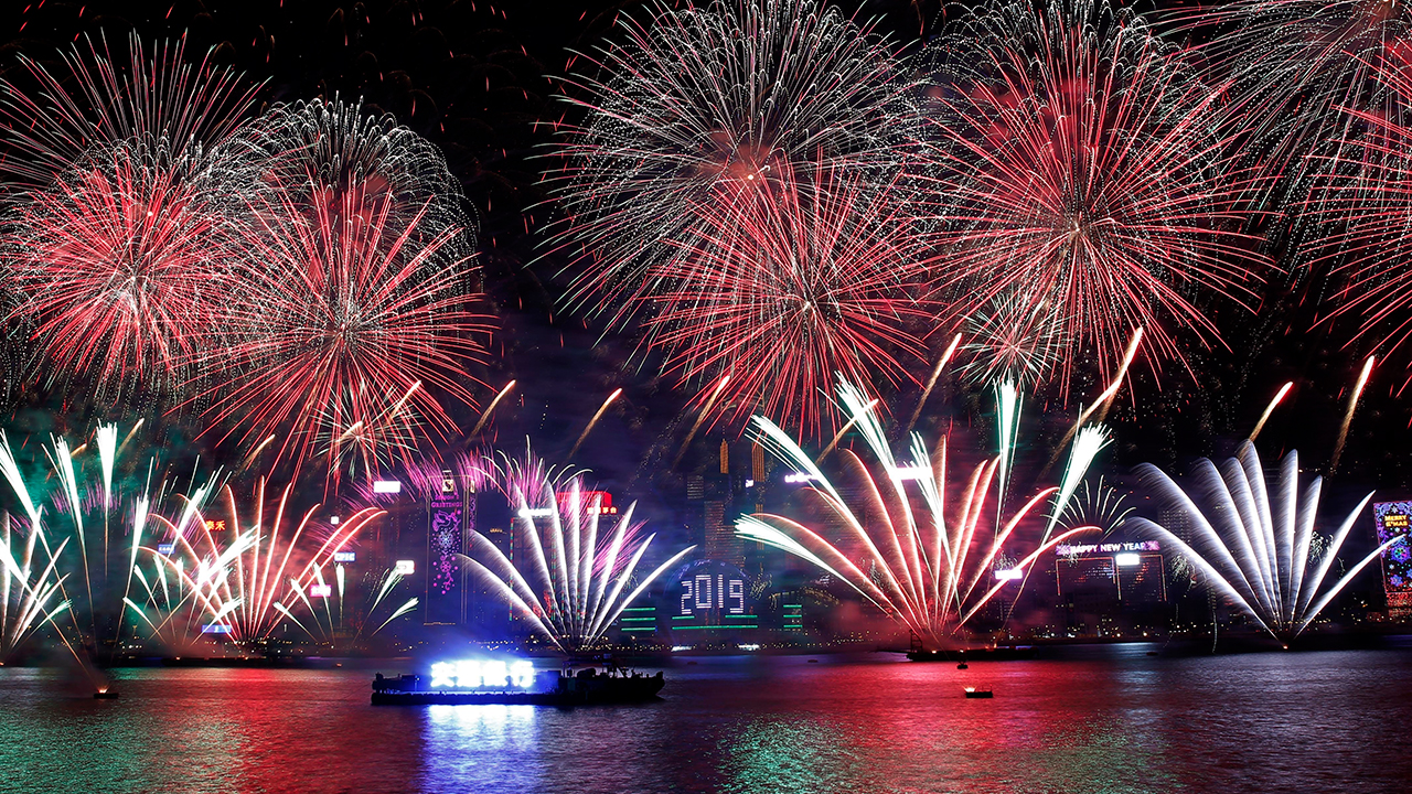 <div class='meta'><div class='origin-logo' data-origin='AP'></div><span class='caption-text' data-credit='AP Photo/Kin Cheung)'>Fireworks explode over the Victoria Harbor during New Year's Eve to celebrate the start of year 2019 in Hong Kong, Tuesday, Jan. 1, 2019.</span></div>