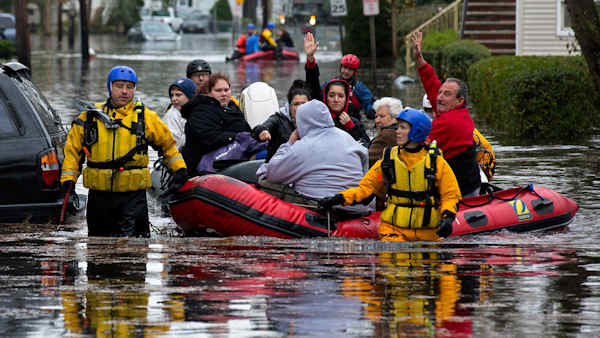 "<div class=""meta image-caption""><div class=""origin-logo origin-image none""><span>none</span></div><span class=""caption-text"">People, some waving to those on dry ground, are rescued by boat in Little Ferry, N.J. Tuesday, Oct. 30, 2012 in the wake of superstorm Sandy, which made landfall Monday. (AP/Craig Ruttle)</span></div>"