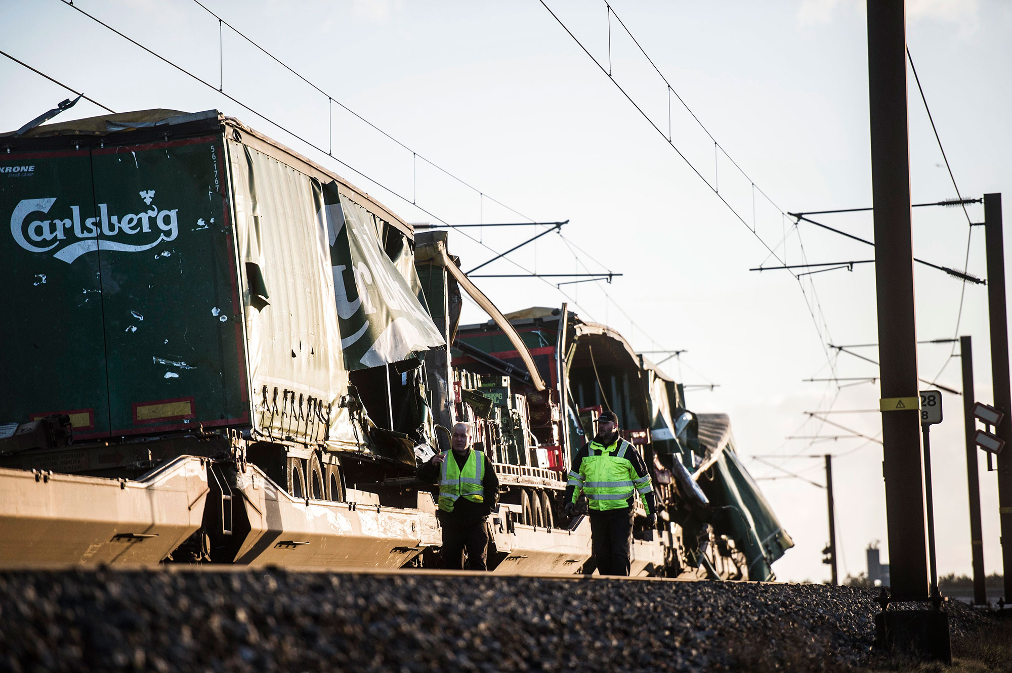<div class='meta'><div class='origin-logo' data-origin='none'></div><span class='caption-text' data-credit='TIM K. JENSEN/AFP/Getty Images'>Two men walk past a damaged cargo train after an accident on January 2, 2019 in Nyborg, Denmark.</span></div>