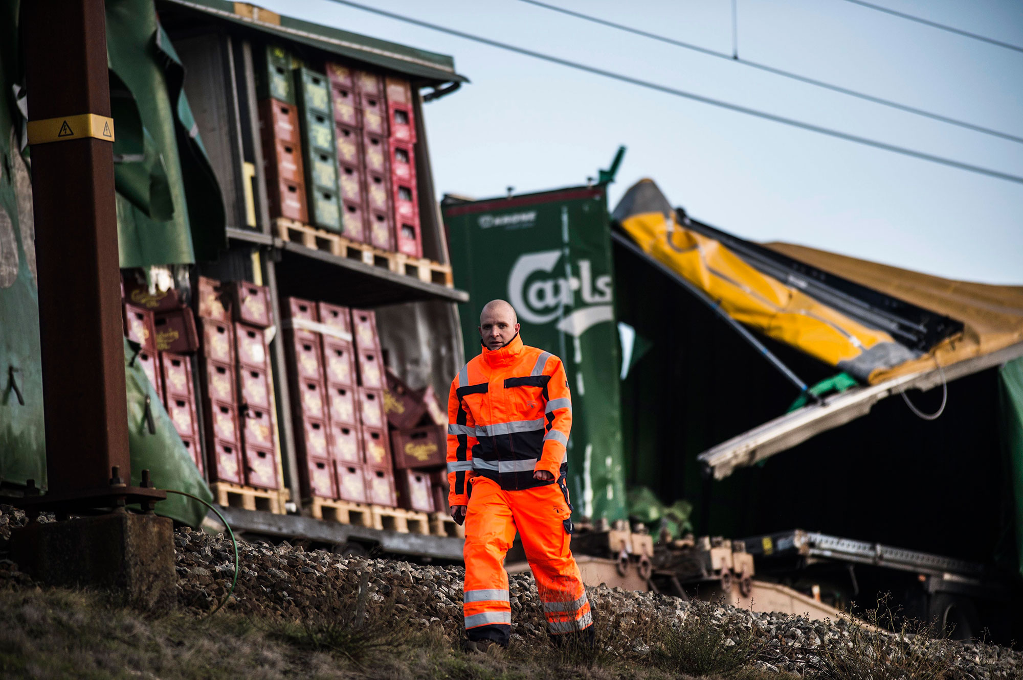 <div class='meta'><div class='origin-logo' data-origin='none'></div><span class='caption-text' data-credit='Tim Kildeborg Jensen / Ritzau Scanpix / AFP'>A staff member walks past damaged containers on a cargo train on the Great Belt Bridge after a railway accident on January 2, 2019 in Nyborg, Denmark.</span></div>