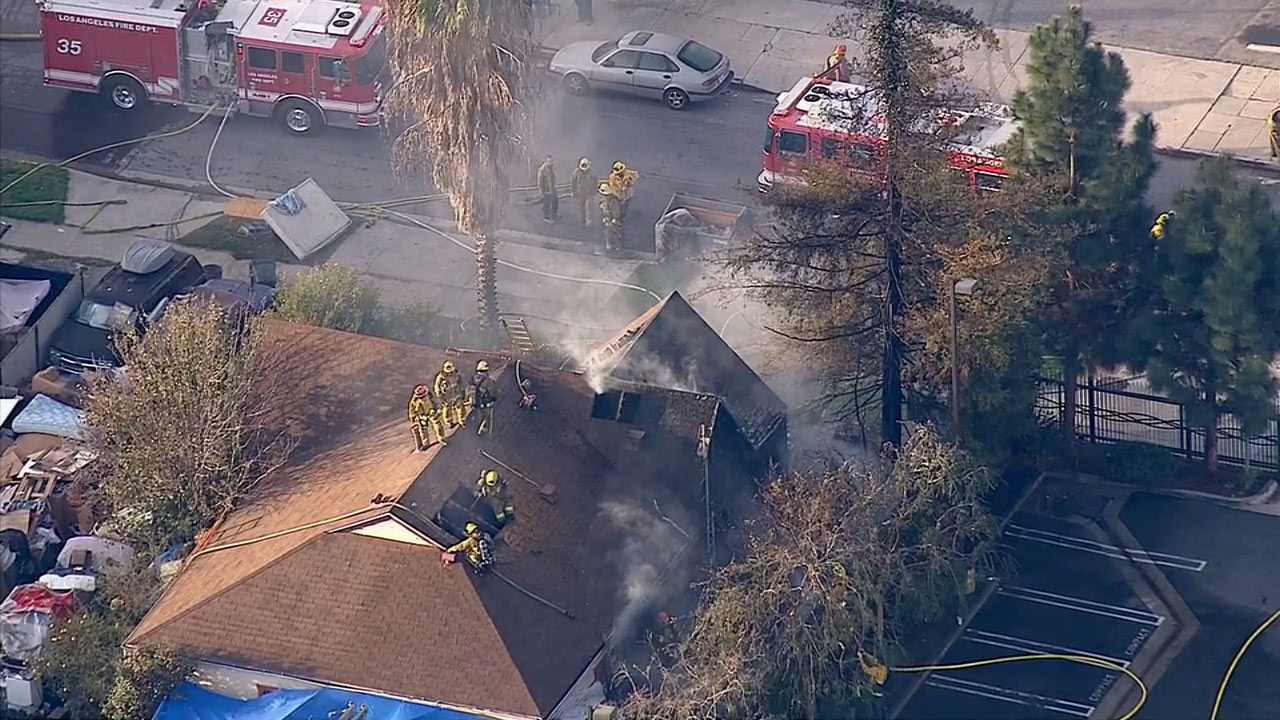 Firefighters respond to a house fire in Los Angeles' Atwater Village neighborhood on Monday, Feb. 2, 2015.