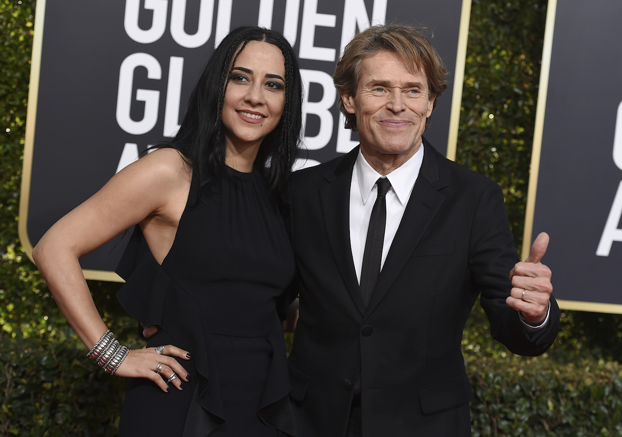 <div class='meta'><div class='origin-logo' data-origin='AP'></div><span class='caption-text' data-credit='Jordan Strauss/Invision/AP'>Willem Dafoe, right, and Giada Colagrande arrive at the 76th annual Golden Globe Awards at the Beverly Hilton Hotel on Sunday, Jan. 6, 2019, in Beverly Hills, Calif.</span></div>