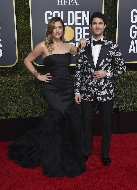 <div class='meta'><div class='origin-logo' data-origin='AP'></div><span class='caption-text' data-credit='Jordan Strauss/Invision/AP'>Mia Swier, left, and Darren Criss arrive at the 76th annual Golden Globe Awards at the Beverly Hilton Hotel on Sunday, Jan. 6, 2019, in Beverly Hills, Calif.</span></div>