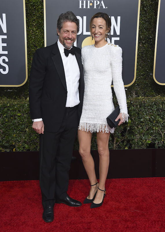 <div class='meta'><div class='origin-logo' data-origin='AP'></div><span class='caption-text' data-credit='Jordan Strauss/Invision/AP'>Hugh Grant, left, and Anna Eberstein arrive at the 76th annual Golden Globe Awards at the Beverly Hilton Hotel on Sunday, Jan. 6, 2019, in Beverly Hills, Calif.</span></div>