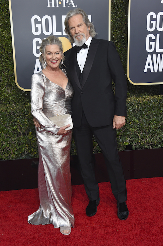 <div class='meta'><div class='origin-logo' data-origin='AP'></div><span class='caption-text' data-credit='Jordan Strauss/Invision/AP'>Jeff Bridges, right, and Susan Geston arrive at the 76th annual Golden Globe Awards at the Beverly Hilton Hotel on Sunday, Jan. 6, 2019, in Beverly Hills, Calif.</span></div>