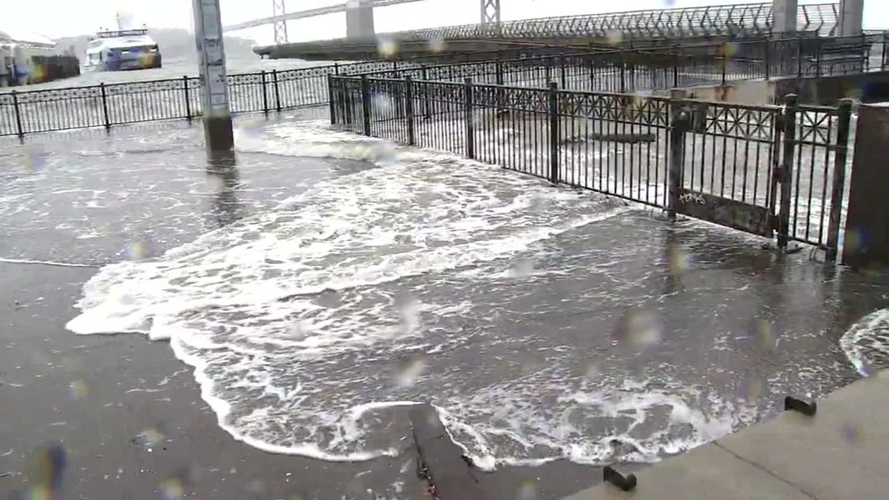 <div class='meta'><div class='origin-logo' data-origin='none'></div><span class='caption-text' data-credit='KGO-TV'>Water floods the Embarcadero in San Francisco on Sunday, January 6, 2019.</span></div>