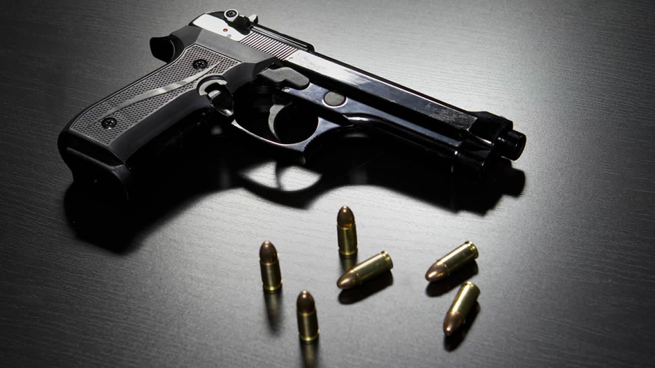 Gun and bullets.