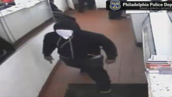 Philadelphia Police searching for suspects wanted for robbing a pizza shop in Logan.