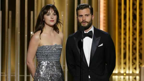 """Fifty Shades of Grey"" starts Dakota Johnson, left, and Jamie Dornan present an award at the 72nd Annual Golden Globe Awards on Sunday, Jan. 11, 2015"