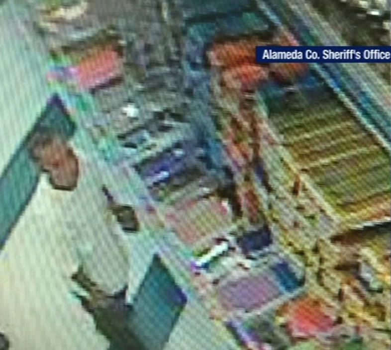 Authorities say surveillance video shows 33-year-old Carlyle Villazon in a 99 Cents Only store near Hayward after molesting an 8-year-old girl on Feb. 1, 2015.
