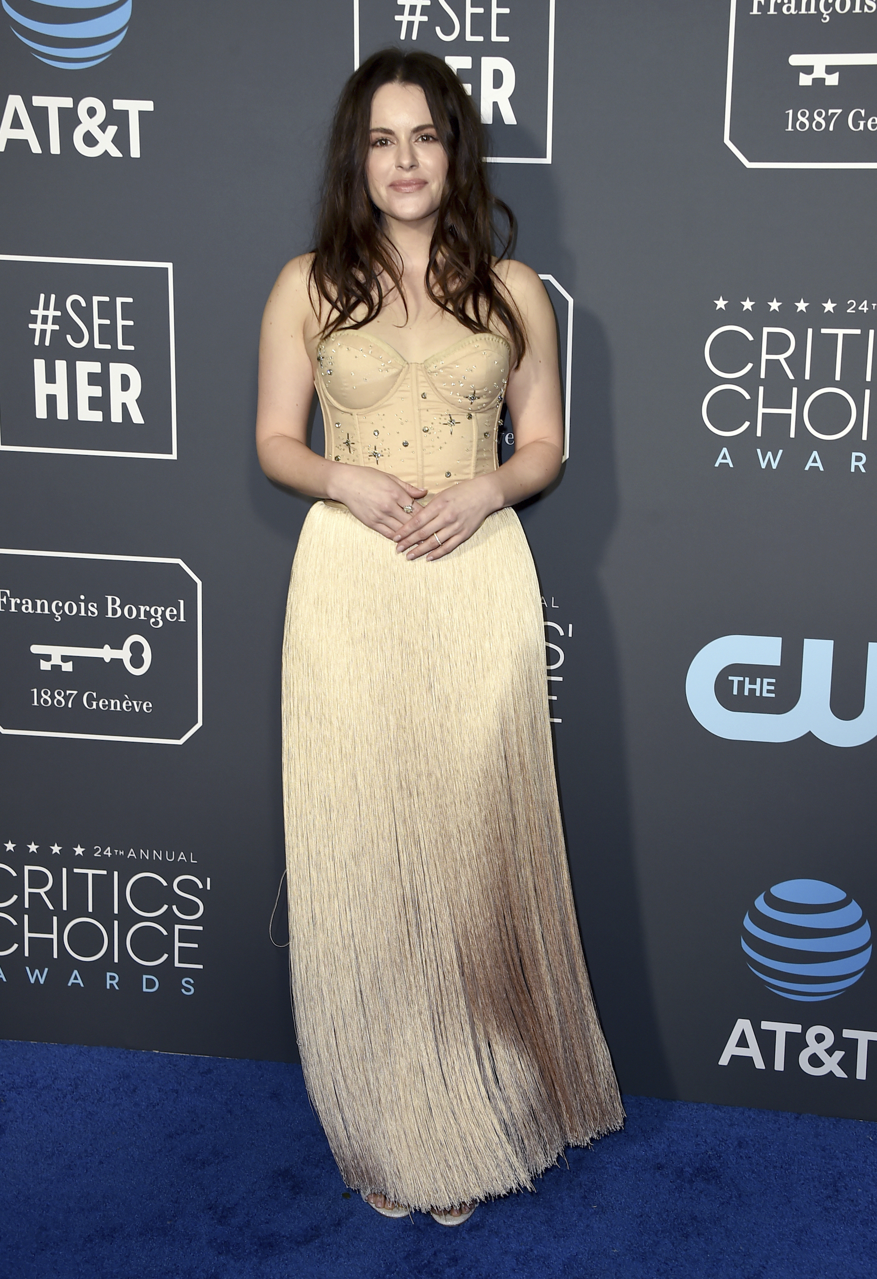 <div class='meta'><div class='origin-logo' data-origin='AP'></div><span class='caption-text' data-credit='Jordan Strauss/Invision/AP'>Emily Hampshire arrives at the 24th annual Critics' Choice Awards on Sunday, Jan. 13, 2019, at the Barker Hangar in Santa Monica, Calif.</span></div>