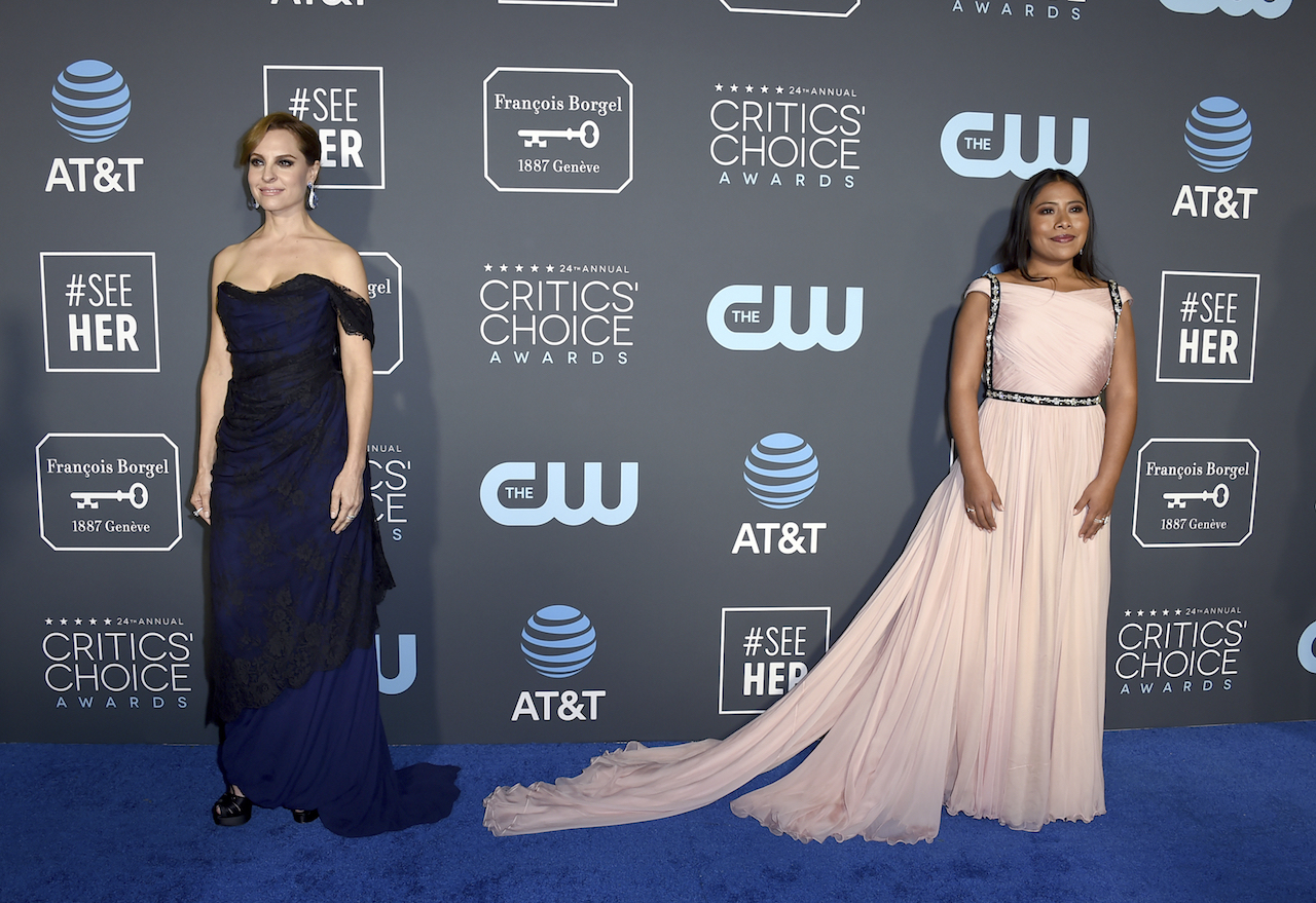 "<div class=""meta image-caption""><div class=""origin-logo origin-image ap""><span>AP</span></div><span class=""caption-text"">Marina De Tavira, left, and Yalitza Aparicio arrive at the 24th annual Critics' Choice Awards on Sunday, Jan. 13, 2019, at the Barker Hangar in Santa Monica, Calif. (Jordan Strauss/Invision/AP)</span></div>"