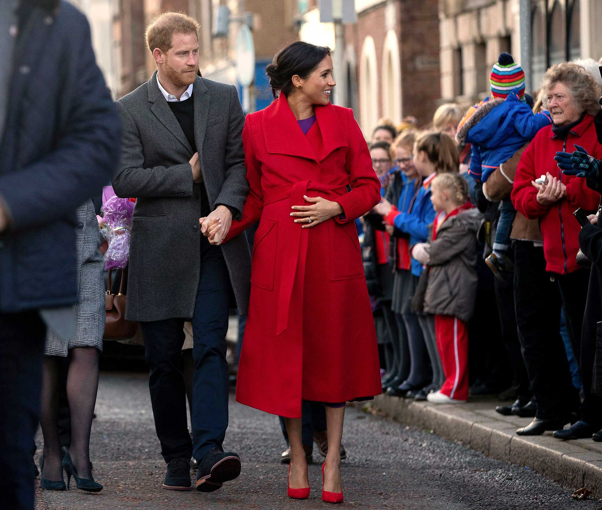 <div class='meta'><div class='origin-logo' data-origin='none'></div><span class='caption-text' data-credit='Charlotte Graham/Daily Telegraph/PA Wire via AP'>Harry and Meghan visit Hamilton Square in Birkenhead to see a new sculpture marking the 100th anniversary of war poet Wilfred Owen's death on Jan. 14, 2019.</span></div>