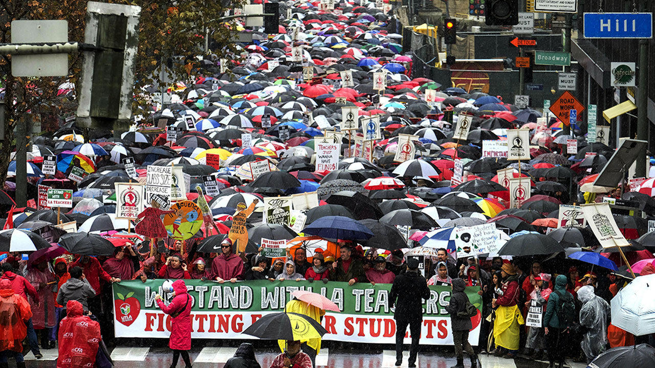 <div class='meta'><div class='origin-logo' data-origin='AP'></div><span class='caption-text' data-credit='AP Photo/Ringo H.W. Chiu'>Thousands of teachers and supporters hold signs in the rain during a rally Monday, Jan. 14, 2019, in Los Angeles.</span></div>