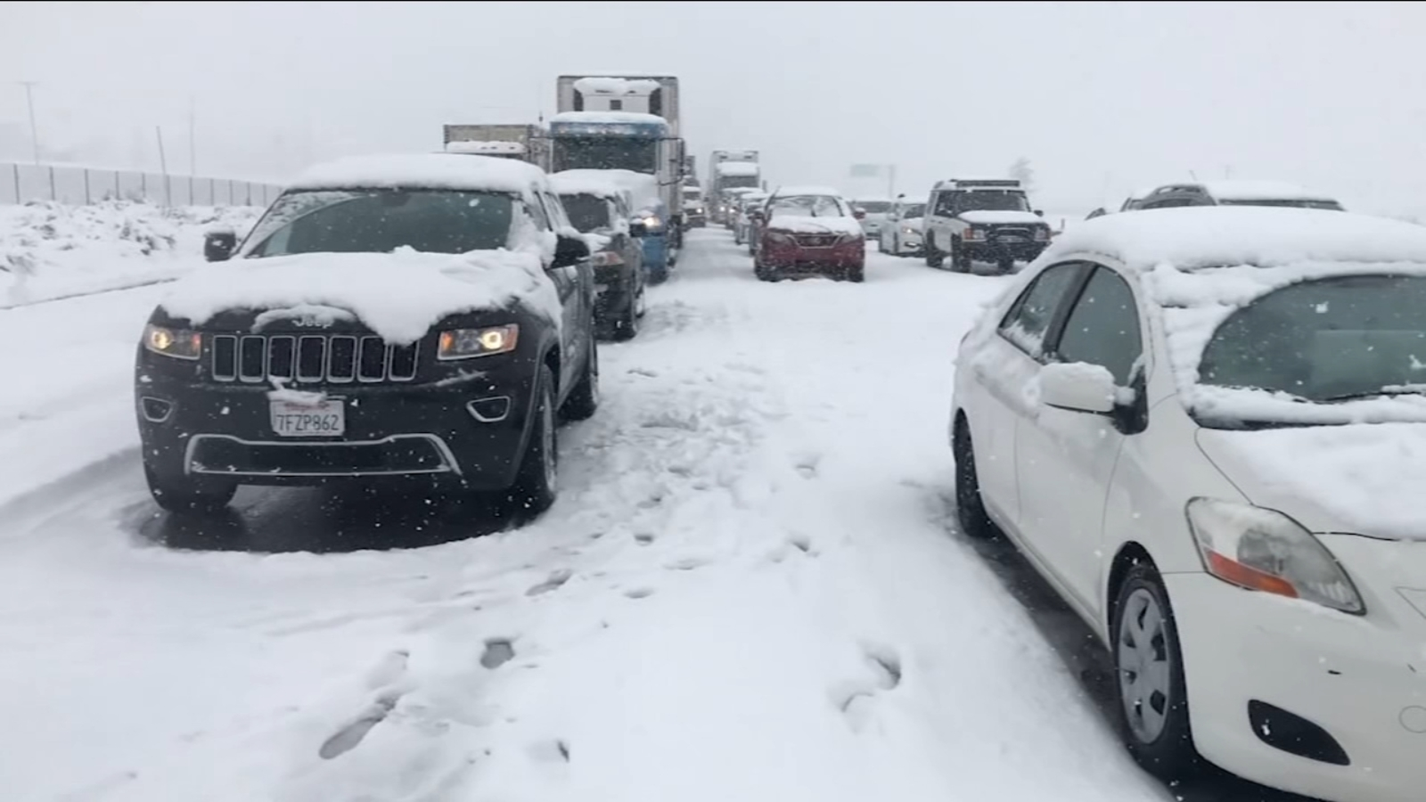 Both directions of I-5 over Grapevine reopen after snow halts traffic