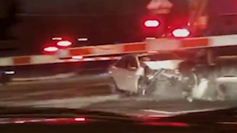 Woman, 96, rescued from car seconds before Metra trains hits