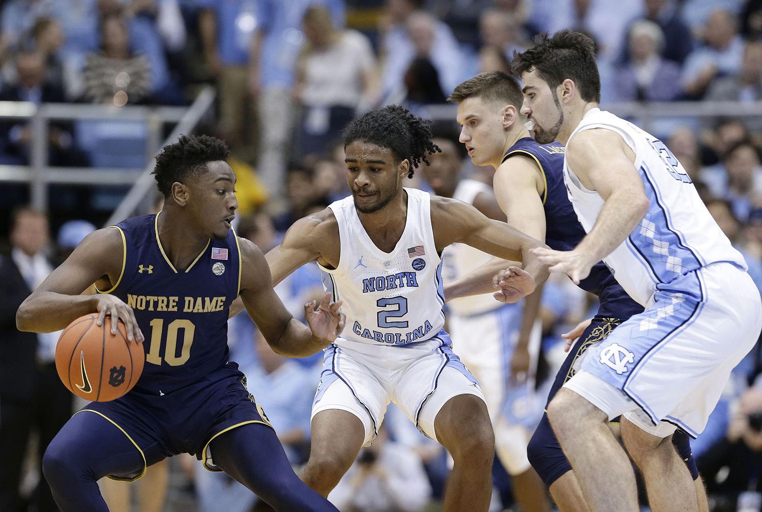 "<div class=""meta image-caption""><div class=""origin-logo origin-image ap""><span>AP</span></div><span class=""caption-text"">Notre Dame's TJ Gibbs (10) dribbles the ball while North Carolina's Coby White (2) and Luke Maye, right, defend. (Gerry Broome)</span></div>"