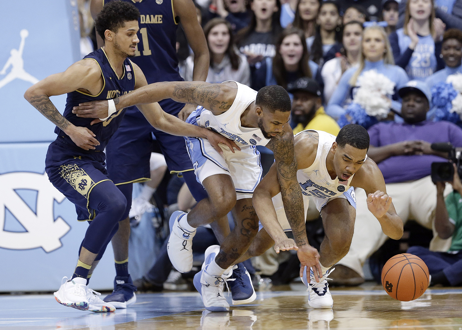 "<div class=""meta image-caption""><div class=""origin-logo origin-image ap""><span>AP</span></div><span class=""caption-text"">Notre Dame's Prentiss Hubb, left, reaches for a loose ball with North Carolina's Seventh Woods and Garrison Brooks, right, (Gerry Broome)</span></div>"