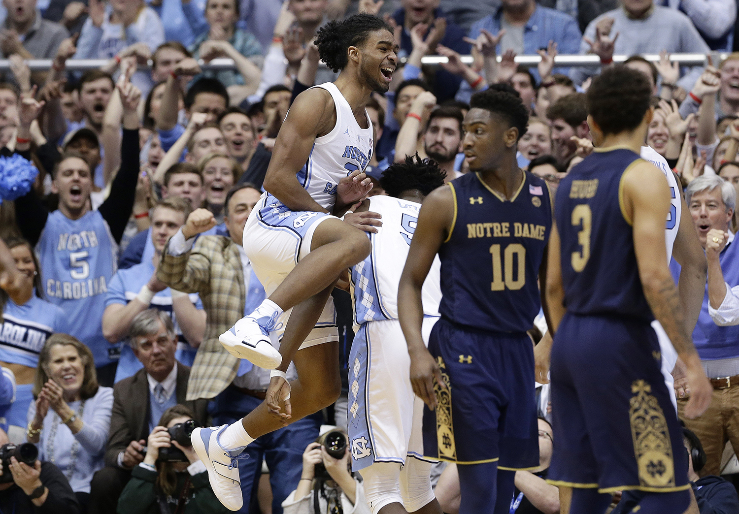 "<div class=""meta image-caption""><div class=""origin-logo origin-image ap""><span>AP</span></div><span class=""caption-text"">North Carolina's Coby White jumps while celebrating with Nassir Little while Notre Dame's TJ Gibbs (10) and Prentiss Hubb (3) walk away. (Gerry Broome)</span></div>"