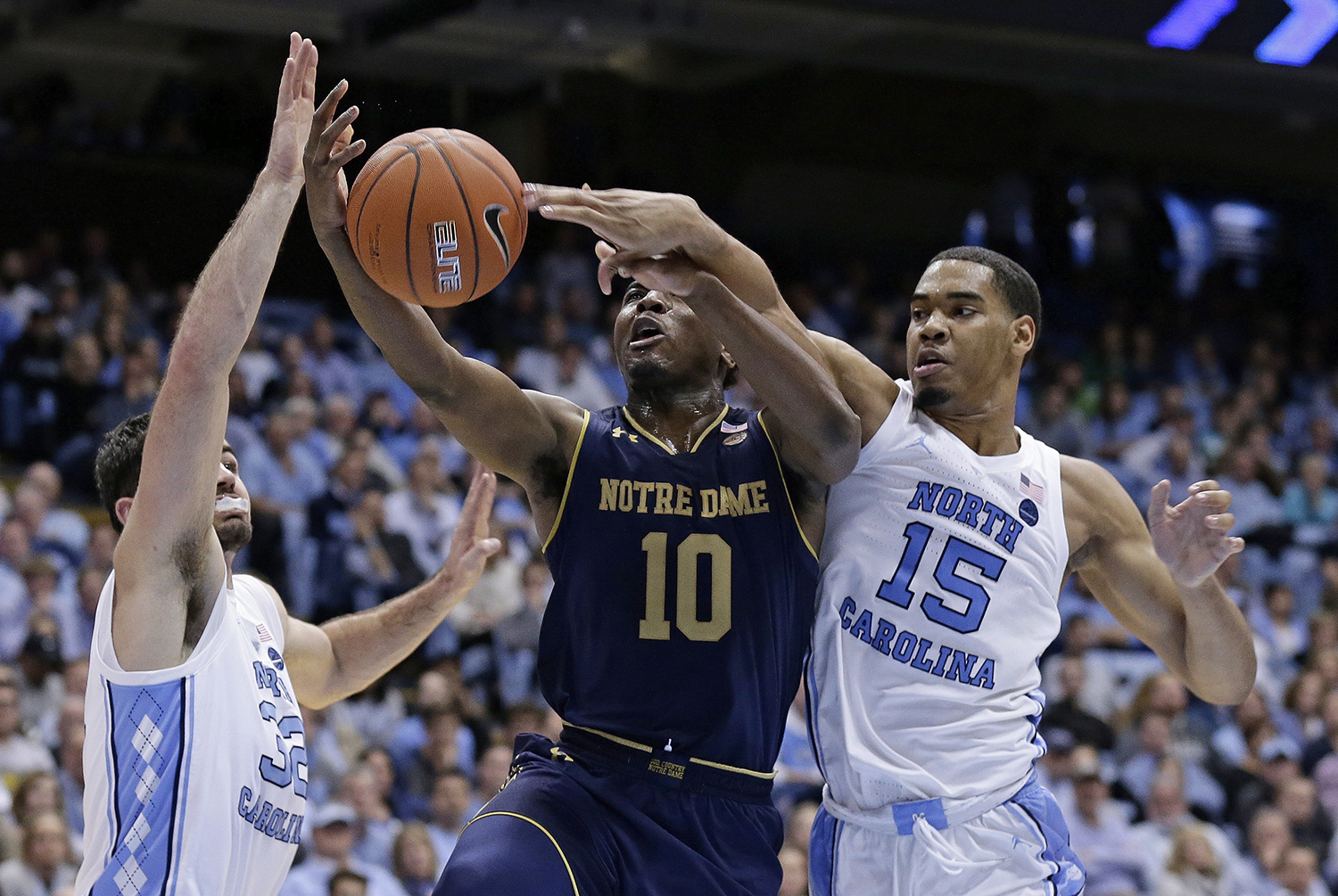 "<div class=""meta image-caption""><div class=""origin-logo origin-image ap""><span>AP</span></div><span class=""caption-text"">North Carolina's Luke Maye, left, and Garrison Brooks (15) guard Notre Dame's TJ Gibbs (10) during the second half. (Gerry Broome)</span></div>"