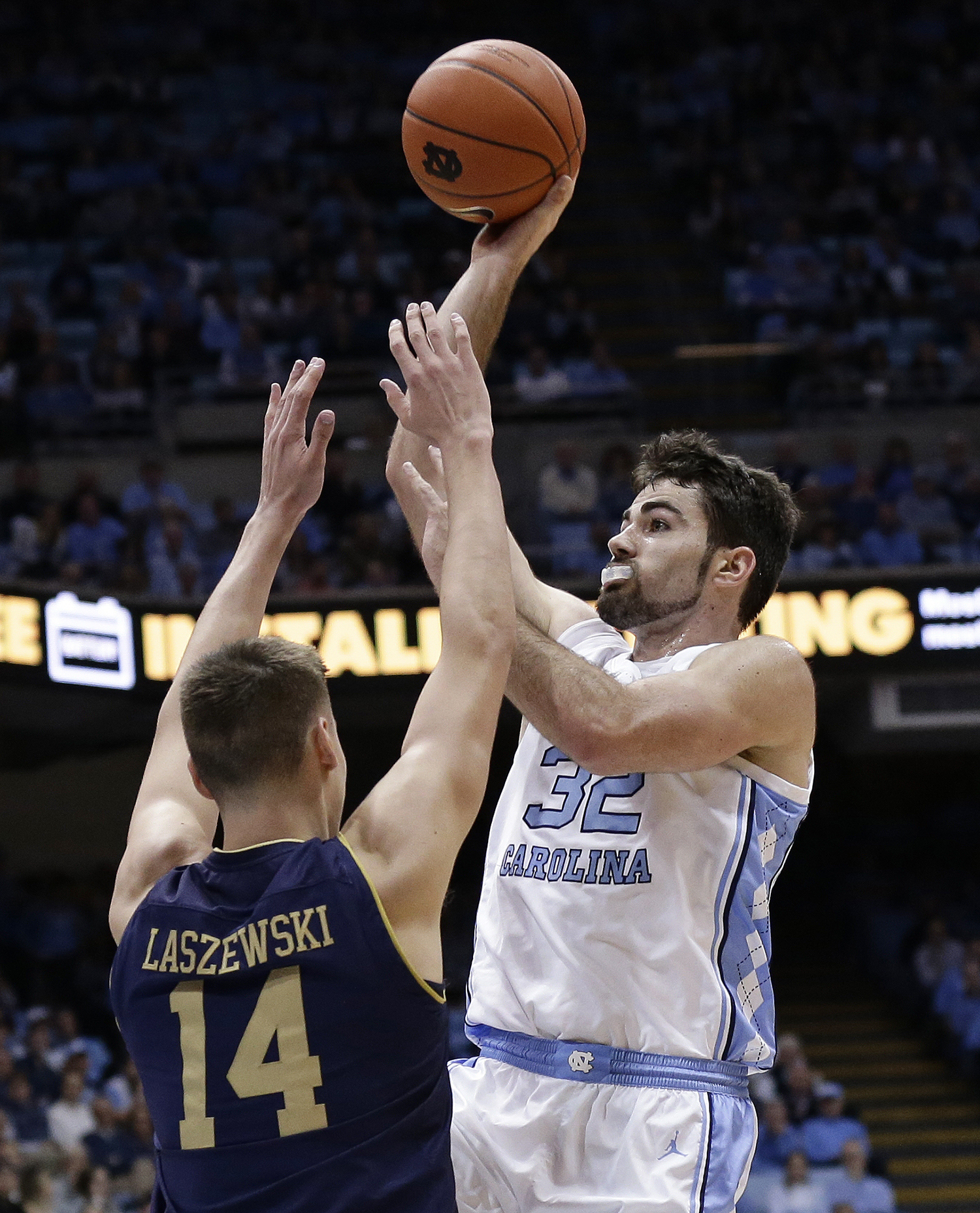 "<div class=""meta image-caption""><div class=""origin-logo origin-image ap""><span>AP</span></div><span class=""caption-text"">North Carolina's Luke Maye (32) shoots while Notre Dame's Nate Laszewski (14) defends during the first half. (Gerry Broome)</span></div>"