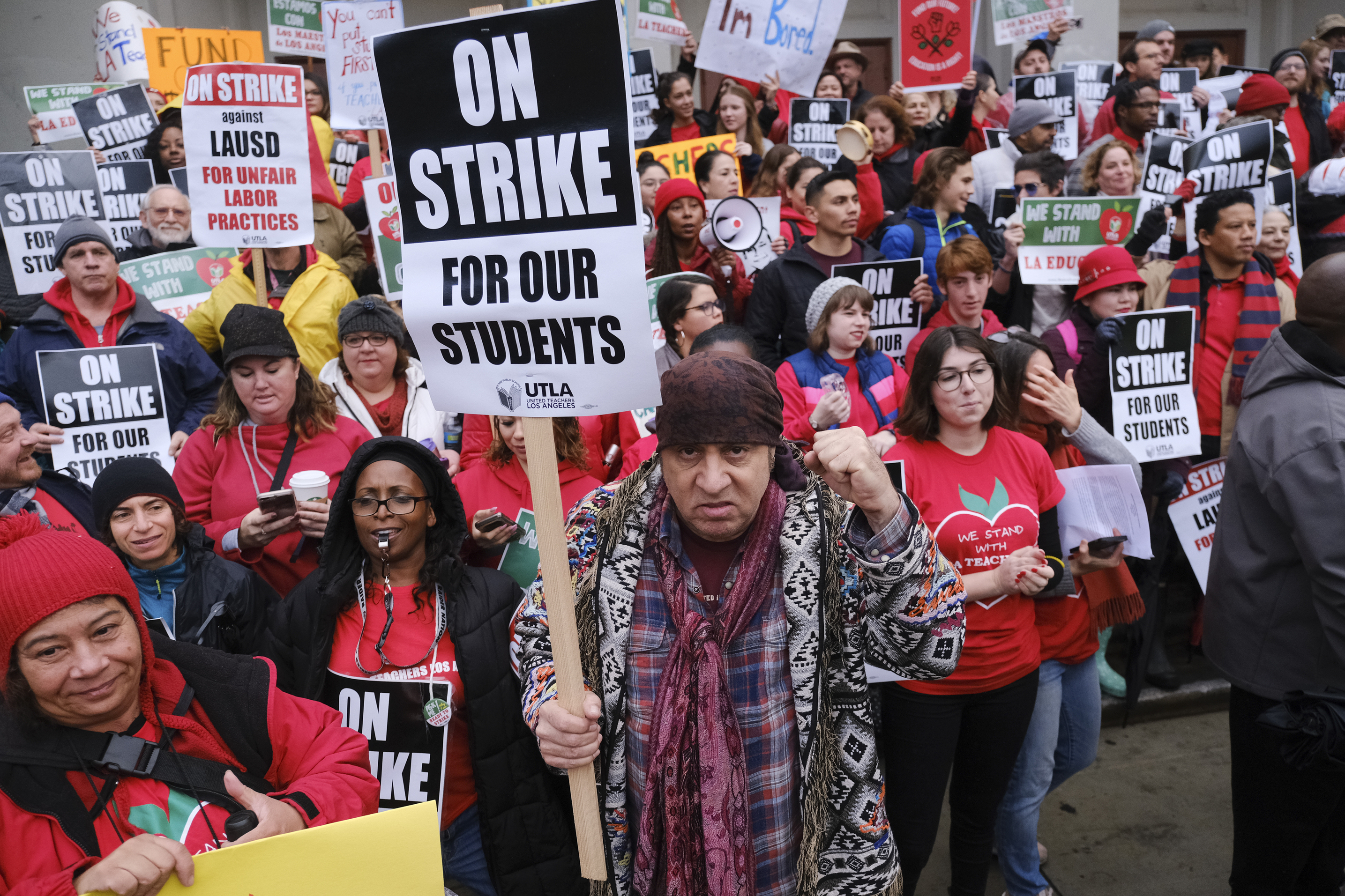 <div class='meta'><div class='origin-logo' data-origin='AP'></div><span class='caption-text' data-credit='Richard Vogel'>Actor, musician and activist, Steven Van Zandt, center, supports striking teachers on the picket in front of Hamilton High School in Los Angeles.</span></div>